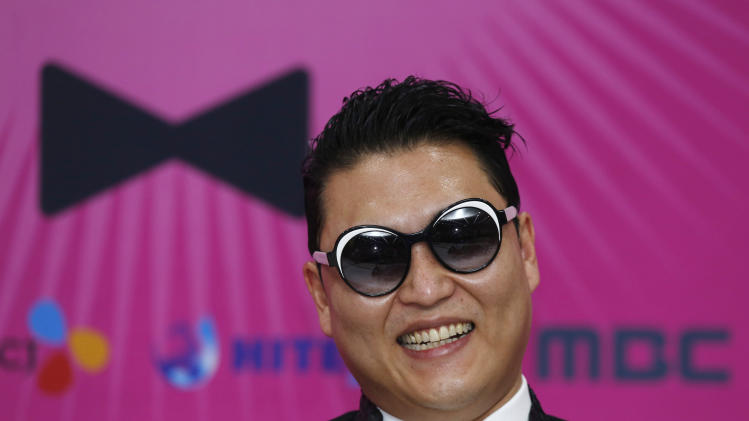 "South Korean rapper PSY smiles during a news conference for his concert ""Happening"" in Seoul, South Korea Saturday, April 13, 2013. PSY is unveiling the music video and choreography for his new single ""Gentleman"" at the Seoul concert. (AP Photo/Kin Cheung)"