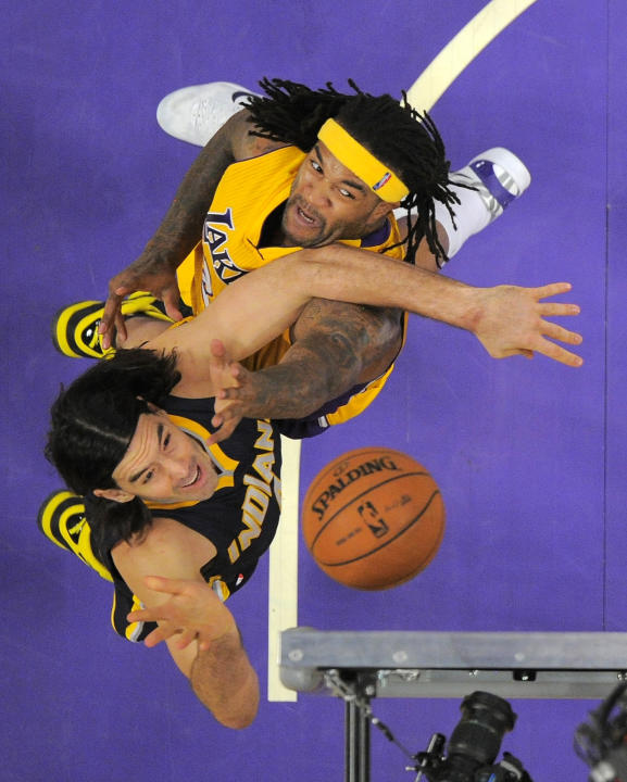 Indiana Pacers forward Luis Scola, of Argentina, below, puts up a shot as Los Angeles Lakers forward Jordan Hill defends during the first half of an NBA basketball game, Tuesday, Jan. 28, 2014, in  Lo