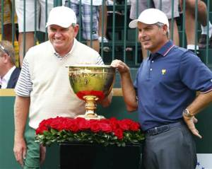 International team captain Nick Price poses next to the Presidents Cup with U.S. team captain Fred Couples before first round play begins in the 2013 Presidents Cup golf tournament at Muirfield Village Golf Club in Dublin