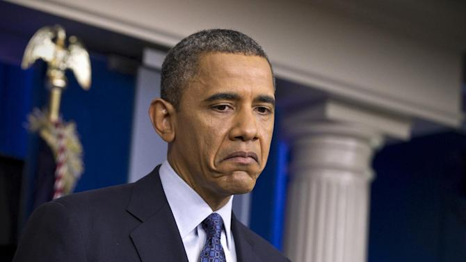 President Barack Obama pauses while talkig about the economy, Friday, June 8, 2012, in the briefing room of the White House in Washington.  (AP Photo/J. Scott Applewhite)