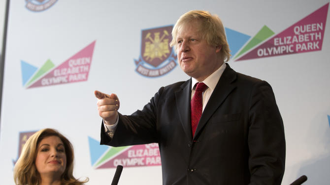Boris Johnson, the Mayor of London, speaks at a press conference in London, Friday, March, 22, 2013, where it was announced that West Ham United, the English Premier League soccer team, will have a 99 year lease to use the London 2012 Olympic stadium starting in 2016. Karen Brady, vice chairman of West Ham United is at left. (AP Photo/Alastair Grant)