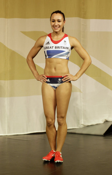 British heptathlete Jessica Ennis poses for photographers in front of a depiction of the British Union Flag during the launch of the team kit that will be worn by British athletes at the London 2012 O