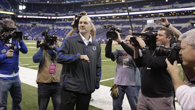 Indianapolis Colts head coach Chuck Pagano acknowledges the fans after walking onto the field before an NFL football game against the Houston Texans, Sunday, Dec. 30, 2012, in Indianapolis. Pagano is back as coach after nearly three months of treatments for leukemia. (AP Photo/Michael Conroy)