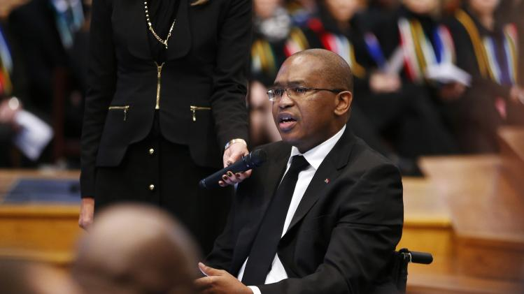 South African Ambassador to Belgium Nkosi speaks during a memorial service for former South African President Mandela in Brussels