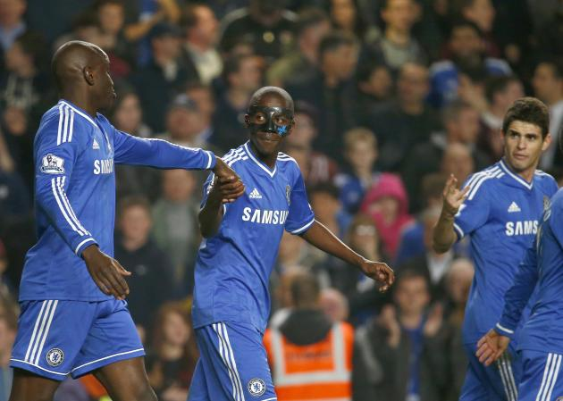 Chelsea's Ba celebrates with team mates Ramires and Oscar after scoring a second goal against Tottenham Hotspur during their English Premier League soccer match at Stamford Bridge in London
