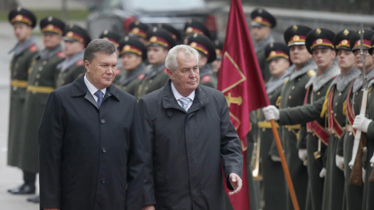 Czech President Milos Zeman, right, and Ukrainian counterpart Viktor Yanukovych review a honor guard during a welcoming ceremony at the presidential residence in Kiev, Ukraine, Monday, Oct. 21, 2013. (AP Photo/Efrem Lukatsky)
