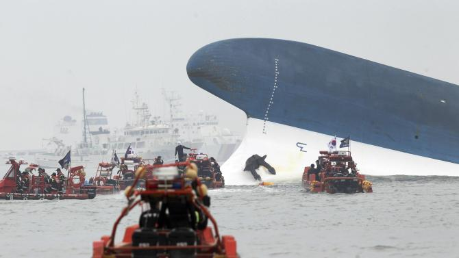 "Part of South Korean passenger ship ""Sewol"" that has been sinking is seen as South Korean maritime policemen search for passengers in the sea off Jindo"