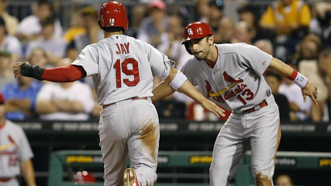St. Louis Cardinals' Jon Jay (19) is greeted by Matt Carpenter as he scores in the seventh inning of a baseball game against the Pittsburgh Pirates on Monday, Aug. 25, 2014, in Pittsburgh. Jay scored from second behind Matt Carpenter on a single by Matt Holiday. (AP Photo/Keith Srakocic)