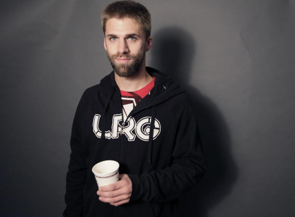 "In this Nov. 17, 2010 photo, Adam Gaynier poses for a portrait in in Dallas. Gaynier, 24, says it will take more than meetings to make people believe in their economic future again. ""Less talk and more walk,"" is what he wants from government. (AP Photo/LM Otero)"