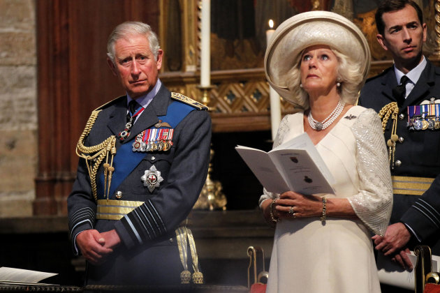 Britain's Prince Charles, left, and Camilla, Duchess of Cornwall attend the Battle of Britain Service of Thanksgiving and Rededication at Westminster Abbey in London, Sunday, Sept. 16, 2012. (AP Photo/Sang Tan, Pool)