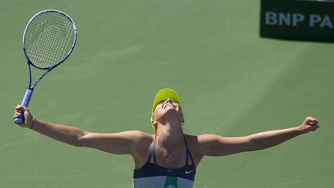 Maria Sharapova, of Russia, celebrates her win over Caroline Wozniacki, of Denmark, in their match at the BNP Paribas Open tennis tournament on Sunday, March 17, 2013, in Indian Wells, Calif. Sharapova won 6-2, 6-2. (AP Photo/Mark J. Terrill)