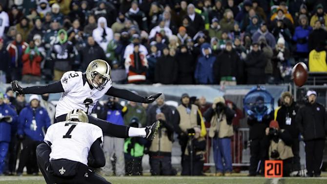 New Orleans Saints' Shayne Graham kicks the game-winning field goal in front of teammate Luke McCown during the second half of an NFL wild-card playoff football game against the Philadelphia Eagles, Saturday, Jan. 4, 2014, in Philadelphia. (AP Photo/Matt Rourke)