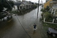 A man walks through a flooded neighborhood after Hurricane Katrina hit the area in 2005 in New Orleans, Louisiana. Google on Monday urged governments to get better at sharing information to allow citizens and first responders to make better use of the Internet during natural disasters
