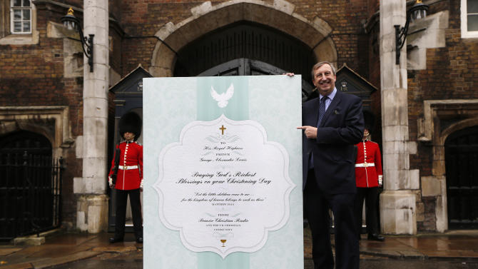 Premier Christian Radio CEO Peter Kerridge poses with a giant christening card, signed by 5,000 Christians, for Prince George and the royal family outside the Chapel Royal, St James's Palace in London ahead of the christening of Prince George, Tuesday, Oct. 22, 2013. The royal christening ceremony of Prince George, son of Prince William and Kate, Duchess of Cambridge is to take place at the Chapel Royal in St James's Palace on Wednesday. (AP Photo/Sang Tan)