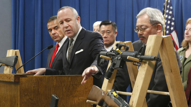FILE - In this Feb. 7, 2013 file photo, Senate President Pro Tem Darrell Steinberg, second from left, gestures to a pair of semi-automatic rifles as he discusses a package of proposed gun control legislation at a Capitol news conference in Sacramento, Calif. Gov. Jerry Brown vetoed Steinbergs's SB374 which would have banned future sales of most semi-automatic rifles that accept detachable magazines, Friday, Oct. 11, 2013.(AP Photo/Rich Pedroncelli,File)