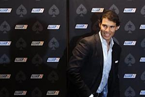 Spanish tennis player Rafael Nadal arrives for a news conference before a celebrity poker tournament, the European Poker Tour Charity Challenge, in Prague