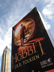 "An inflatable balloon featuring the cover of J.R.R. Tolkien's book ""The Hobbit"" is displayed at a book fair in Germany. Animal rights group PETA said up to 27 animals, including horses, sheep, goats and chickens, died during the filming of ""The Hobbit"" in New Zealand"