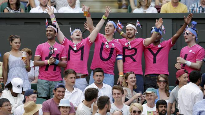 Fans of Andy Murray of Britain cheer during his match against Andreas Seppi of Italy at the Wimbledon Tennis Championships in London
