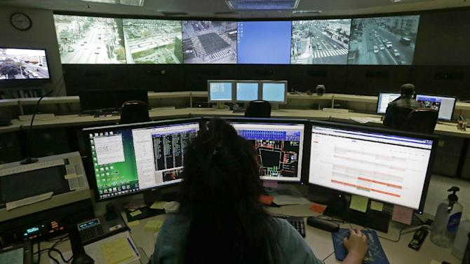 In this Wednesday, April 24, 2013 photo, transportation engineer associate Abeer Kliefe works at the Los Angeles Department of Transportation's Automated Traffic Surveillance and Control Center in downtown Los Angeles. The nation's most congested city has become a model for traffic control. With the flip of a switch earlier this year, Los Angeles became a worldwide leader by synchronizing all of its nearly 4,400 stoplights, making it the world's first major city to do so. (AP Photo/Reed Saxon)