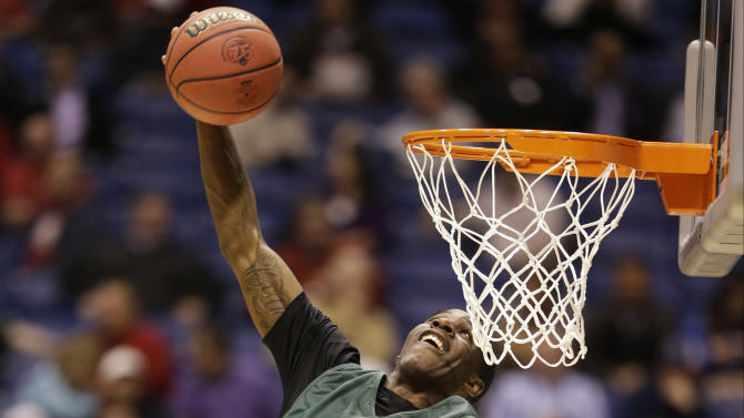 Oregon guard Damyean Dotson goes up with a shot during practice for a regional semifinal game in the NCAA college basketball tournament Thursday, March 28, 2013, in Indianapolis. Oregon plays Louisville on Friday. (AP Photo/Darron Cummings)