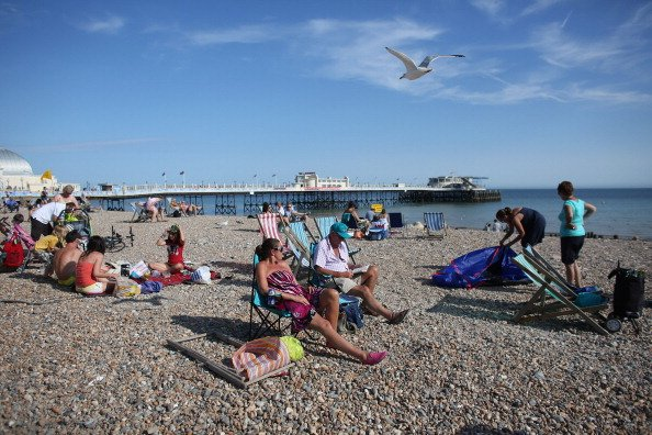 Members of the public enjoy the warm weather at the seaside on August 18, 2012 in Worthing, England. Many areas of the UK are experiencing the hottest day of the year so far, with some parts seeing th