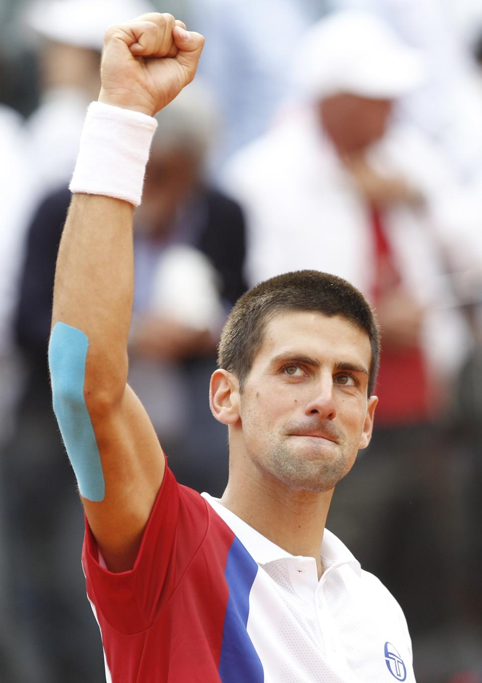 Serbia's Novak Djokovic celebrates after defeating France's Jo-Wilfried Tsonga at the Italian Open tennis tournament, in Rome, Friday, May 18, 2012. Djokovic won 7-5, 6-1. (AP Photo/Andrew Medichini)