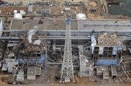 This view of two stricken reactors at the Fukushima nuclear power plant was taken by an unmanned aerial vehicle in March 2011. Japan's prime minister at the time of the Fukushima nuclear crisis has apologised and said the government and its push for nuclear energy bore most of the responsibility for the disaster