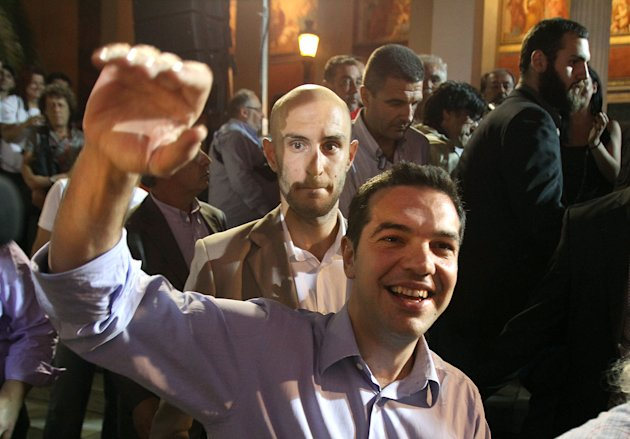 Head of Greece's radical left-wing Syriza party Alexis Tsipras waves to his supporters in Athens, late Sunday, June 17, 2012. Alexis Tsipras and his party shot to prominence in the May 6 vote, where he came a surprise second and quadrupled his support since the 2009 election. Syriza party has vowed to rip up Greece's bailout agreements and repeal the austerity measures, which have included deep spending cuts on everything from health care to education and infrastructure, as well as tax hikes and reductions of salaries and pensions. (AP Photo/Petros Karadjias)