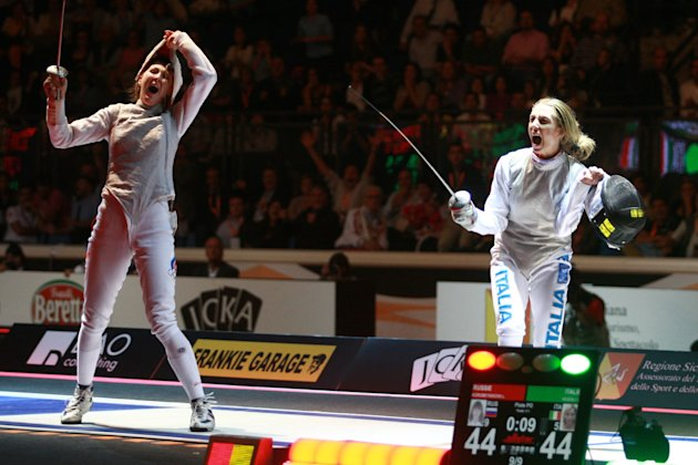Russia's Larisa Korobeynikova (L) reacts as she scores the last point against Italy's Valentina Vezzali at the end of the final of the Women's Team Foil competition at the 2011 World Fencing Champions
