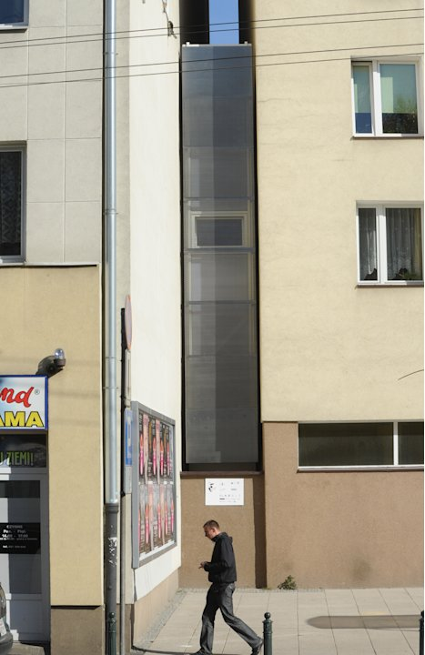 "A passerby walks past one of the world's narrowest houses, in Warsaw, Poland, Friday, Oct. 19, 2012. The two-level ""Keret's House"" is no wider than 122 centimeters (48.03 inches) and was fitted into t"