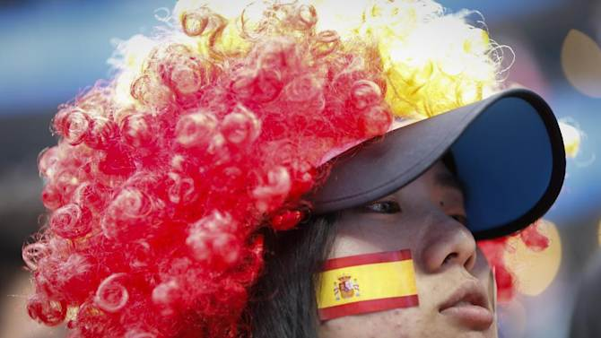 A supporter of Rafael Nadal of Spain wears a wig during the China Open tennis tournament at the National Tennis Stadium in Beijing, China, Thursday, Oct. 2, 2014