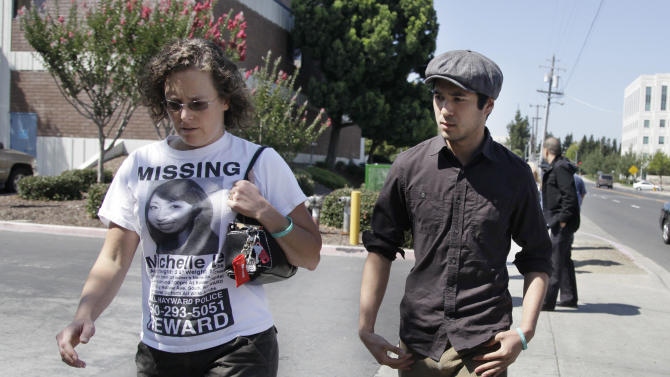 Scott Marasigan, right, ex-boyfriend of Giselle Esteban, leaves a Hayward, Calif., courtroom with a woman who did not want to be identified after Esbeban's arraignment, Friday, Sept. 9, 2011. Police arrested Esteban in connection with the disappearance of Michelle Le, 26, a nursing student, who was last seen in Hayward more than three months ago, police say.  (AP Photo/Paul Sakuma)