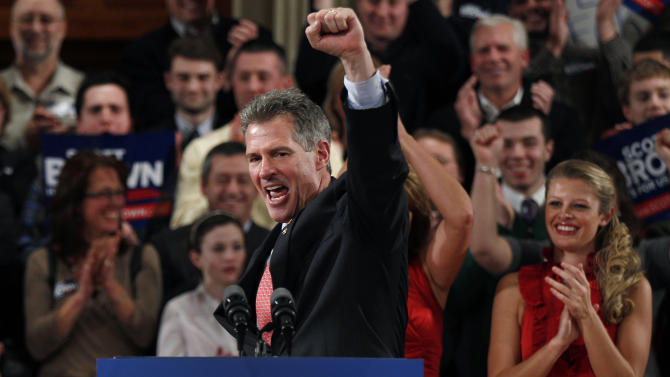 FILE - U.S. Sen. Scott Brown, R-Mass., pumps his fist during his re-election campaign kick-off in Worcester, Mass., in this Jan. 19, 2012 file photo. If Sen. John Kerry is confirmed by the Senate for secretary of state, as expected, Kerry would have to resign the seat he's held for nearly three decades, prompting a special election _ the state's third Senate contest since 2010. Already, jockeying is well under way. The big question is whether Republican Sen. Scott Brown will go for the seat, after losing his last month to Democratic challenger Elizabeth Warren. (AP Photo/Charles Krupa, File)