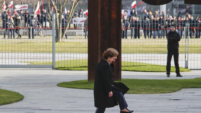 German Chancellor Merkel walks with Polish Prime Minister Szydlo to listen to national anthems during a ceremony at the Chancellery in Berlin