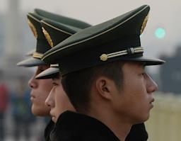 Chinese para-military police are seen standing …