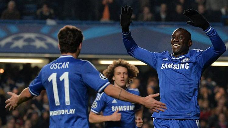 Chelsea's Demba Ba (R) celebrates with teammates after scoring the opening goal during their UEFA Champions League Group E match against Steaua Bucharest, at Stamford Bridge in London, on December 11, 2013