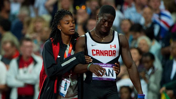 Canada loses bronze medal in the Olympic men's 4x100 relay because of Jared Connaughton's lane violation.