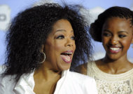 Oprah Winfrey, recipient of the Power Award, reacts to photographers at the 6th Annual Black Women in Hollywood Luncheon at the Beverly Hills Hotel on Thursday, Feb. 21, 2013 in Los Angeles. (Photo by Chris Pizzello/Invision/AP)