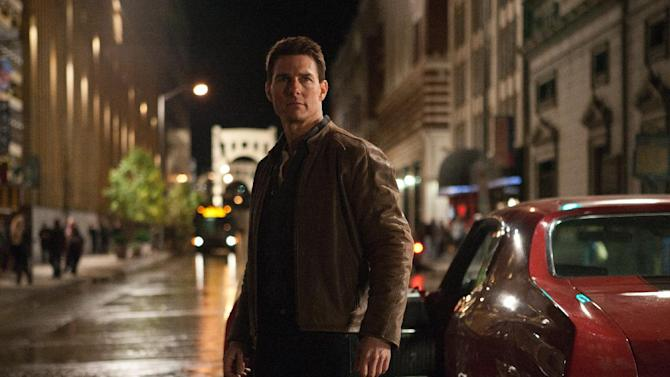 """In this publicity photo provided by Paramount Pictures, actor Tom Cruise, center, is Jack Reacher in film, """"Jack Reacher,"""" from Paramount Pictures and Skydance Productions. Paramount Pictures has released the trailer for Cruise's crime drama """"Jack Reacher,"""" which opens Dec. 21. The trailer launched with Tuesday's debut of """"The Amazing Spider-Man."""" (AP Photo/Paramount Pictures, Karen Ballard)"""