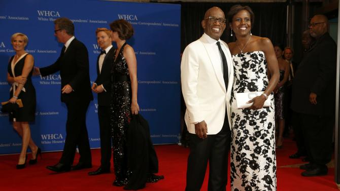 Journalists Roker and Roberts arrive for the annual White House Correspondents' Association dinner in Washington