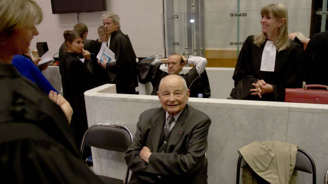 """Jacques Servier, center, founder of Servier Laboratories, sits with his lawyers during the opening of the trial at Nanterre's court house, outside Paris, Monday, May 14, 2012. A French court has opened the first of trials over a drug for diabetes commonly used to lose weight and suspected of killing at least 500 people. The pharmaceutical group Servier is suspected of """"aggravated deception"""" for hiding the fact that the drug known as Mediator contained an amphetamine, benfluorex _ removed from the market in 2009 after being found to thicken heart valves. (AP Photo/Michel Euler)"""