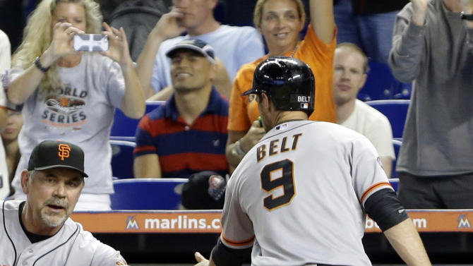 Pence powers Giants to 14-10 win over Marlins