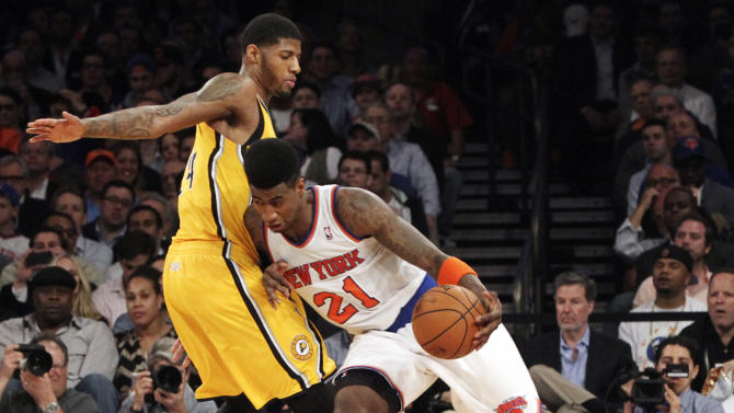 New York Knicks' Iman Shumpert drives past Indiana Pacers' Paul George in the first half of Game 2 of their NBA basketball playoff series in the Eastern Conference semifinals at Madison Square Garden in New York, Tuesday, May 7, 2013. The Knicks won 105-79. (AP Photo/Mary Altaffer)