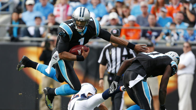 Carolina Panthers' Cam Newton (1) is upended by a Denver Broncos player during the first half of an NFL football game in Charlotte, N.C., Sunday, Nov. 11, 2012. (AP Photo/Bob Leverone)