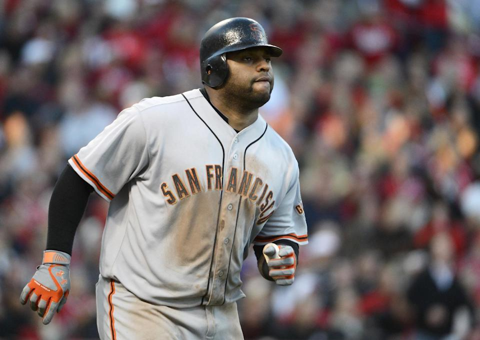 San Francisco Giants' Pablo Sandoval watches his two-run home run in the seventh inning of Game 4 of the National League division baseball series against the Cincinnati Reds, Wednesday, Oct. 10, 2012, in Cincinnati. (AP Photo/Michael Keating)