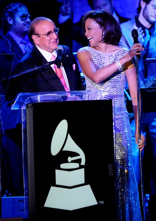 Producer Clive Davis (L) and singer Whitney Houston speak onstage at the 2011 Pre-GRAMMY Gala and Salute To Industry Icons Honoring David Geffen at Beverly Hilton on February 12, 2011 in Beverly Hills