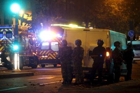 French riot police secure the area near the Bataclan concert hall following a fatal shooting at a restaurant in Paris, France