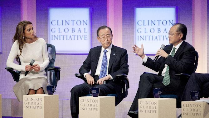 Queen Rania Al Abdullah, left, and United Nations Secretary-General Ban Ki-Moon, center, listen to Jim Yong Kim, right, president of the World Bank, at the Clinton Global Initiative, Sunday, Sept. 23, 2012 in New York. (AP Photo/Mark Lennihan)