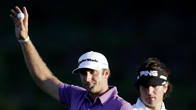 Dustin Johnson acknowledges the crowd after hitting an eagle on the 18th hole during the second round at the Tournament of Champions PGA golf tournament as Bubba Watson watches, Monday, Jan. 7, 2013, in Kapalua, Hawaii. (AP Photo/Elaine Thompson)
