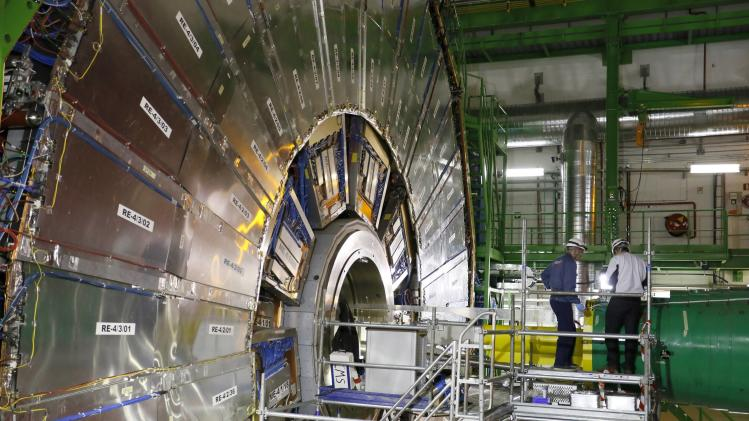 Technicians are seen working in the CMS experiment during a media visit to CERN in the French village of Cessy